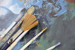 Painting. Set of bristles over paint smudges Stock Photo