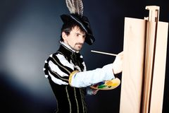 Painting. Portrait of a handsome man artist in 16th century costume. Shot in a studio Stock Photo