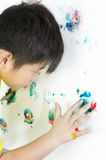 Painting. Child painting with his handson the wall royalty free stock photos