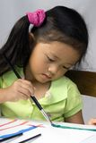 Painting 3. A young girl creates a self portrait with paint royalty free stock images