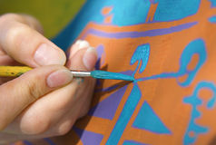 Painting. Artist hand with brush painting watercolour Royalty Free Stock Images