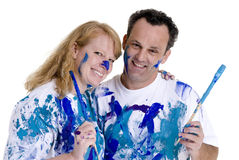 Painting. A married couple having fun painting with finger paint Royalty Free Stock Images