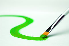 Painting. Green paint on white canvas Royalty Free Stock Photography
