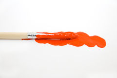 Painting. Red gouache and paintbrush isolated on white Royalty Free Stock Photos
