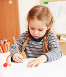 Painting. Cute little girl painting at home royalty free stock photography