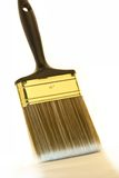 Painting. A brush on a white background for painting walls Stock Photos