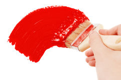 Painting. With the red brush Royalty Free Stock Photography