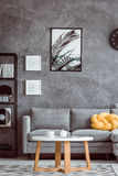 Painting above grey settee Royalty Free Stock Photos