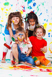 Painting activity. Keeping four kids busy royalty free stock photos