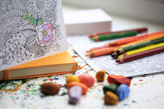 Painting for adult with color pencils and crayons. Yellow moleskine notebook. Royalty Free Stock Photo