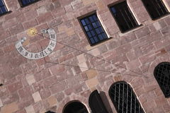 Painting of ancient sun clock. On the one facade in Nurnberg, Germany stock photos