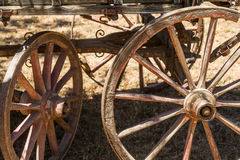 Painting antique wooden cart with big wheels on harvest. Stock Image