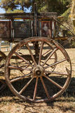 Painting antique wooden cart with big wheels on harvest. Stock Images