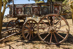Painting antique wooden cart with big wheels on harvest. Stock Photography