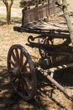 Painting antique wooden cart with big wheels on harvest. Royalty Free Stock Photos
