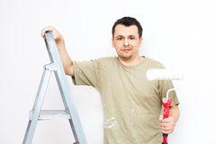 Painting the apartment. Man is painting apartment and his nose Stock Photos