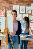 Paint art class dilute watercolor teacher student. Painting art classes. drawing courses. skills imagination and inspiration. student girl creating picture on royalty free stock photos