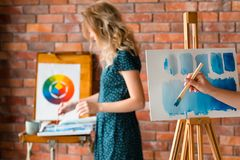 Paint art class dilute watercolor teacher student. Painting art classes. drawings creation. learning to dilute watercolor. teacher and student communication royalty free stock photo