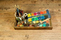 Painting art supplies brushes and colors for artistic creativity Stock Photo