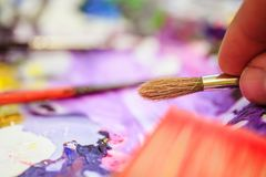 Painting artwork: paint brushes on painting background. Artist paint brush on painting background. Painting therapy drawing creative inspiration motivation royalty free stock photos