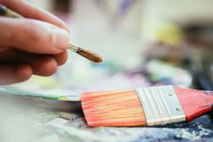 Painting artwork: paint brushes on painting background. Artist paint brush on painting background. Painting therapy drawing creative inspiration motivation royalty free stock image