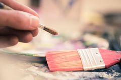 Painting artwork: paint brushes on painting background. Artist paint brush on painting background. Painting therapy drawing creative inspiration motivation royalty free stock photography