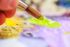 Painting artwork: paint brushes on painting background. Artist paint brush on painting background. Painting therapy drawing creative inspiration motivation stock photo
