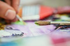 Painting artwork: paint brushes on painting background. Artist paint brush on painting background. Painting therapy drawing creative inspiration motivation stock image