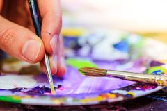 Painting artwork: paint brushes on painting background. Artist paint brush on painting background. Painting therapy drawing creative inspiration motivation stock photography