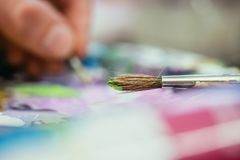 Painting artwork: paint brushes on painting background. Artist paint brush on painting background. Painting therapy drawing creative inspiration motivation royalty free stock photo
