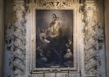 Painting of the ascension of Madonna and Child above one of the altars, Basilica di Santa Croce. Pictured is a painting of the ascension of Madonna and child Royalty Free Stock Photo