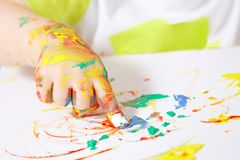 Painting baby hand. Baby hand painting on the paper Royalty Free Stock Images