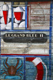 Painting on beach hut. With blue and red colours stock photo