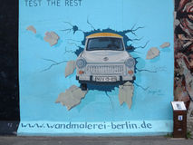 Painting on Berlin wall at East Side Gallery Stock Image