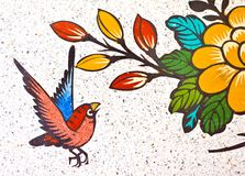 Painting of a bird on the wall Stock Photo