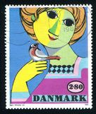 Painting by Bjorn Wiinblad. DENMARK - CIRCA 1986: stamp printed by Denmark, shows Painting by Bjorn Wiinblad, circa 1986 Royalty Free Stock Photography