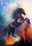 Painting of a black unicorn dancing in space Stock Photo