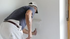 Painting blank wall stock video