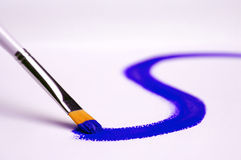 Painting blue. Painting with blue on white canvas Royalty Free Stock Image