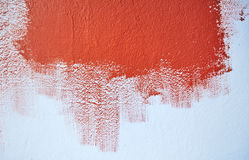 Painting the blue wall with red color Royalty Free Stock Photos
