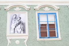 Painting and blue window Royalty Free Stock Photography