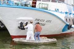 Painting a boat the unorthodox way Stock Photography