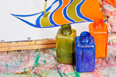 Painting and bottles with dyes Stock Images