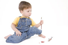 Painting boy. Small boy drawing a picture Royalty Free Stock Photos