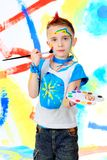 Painting boy. Portrait of a beautiful child enjoying his painting. Education Stock Images