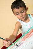 Painting boy. Portrait of a painting boy Stock Images