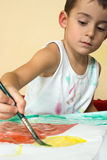 Painting boy. Portrait of a painting boy Royalty Free Stock Image
