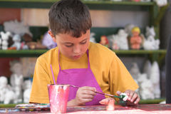 Painting boy. Portrait of a painting boy Royalty Free Stock Images