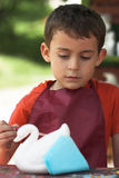 Painting boy. Portrait of a painting boy Royalty Free Stock Photography