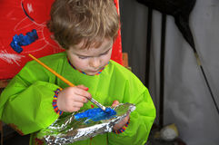 Painting boy Royalty Free Stock Images